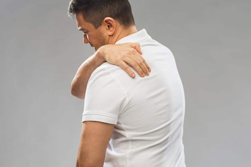 Close up of man suffering from pain in upper back