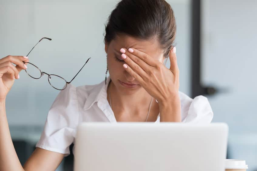Lady suffers from eye strain or migraine coping with dizziness blood pressure tired of computer work